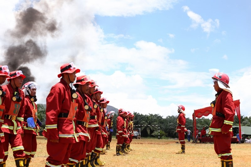 Villagers taking part in fire suppression training