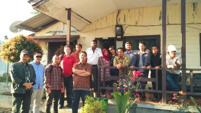 Taking a moment for a photo after a site visit with suppliers in Aceh